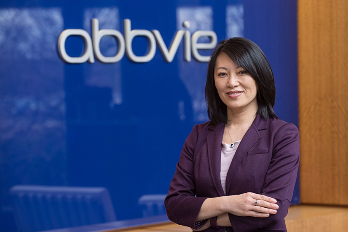 Betty Yao in front of a navy AbbVie background.
